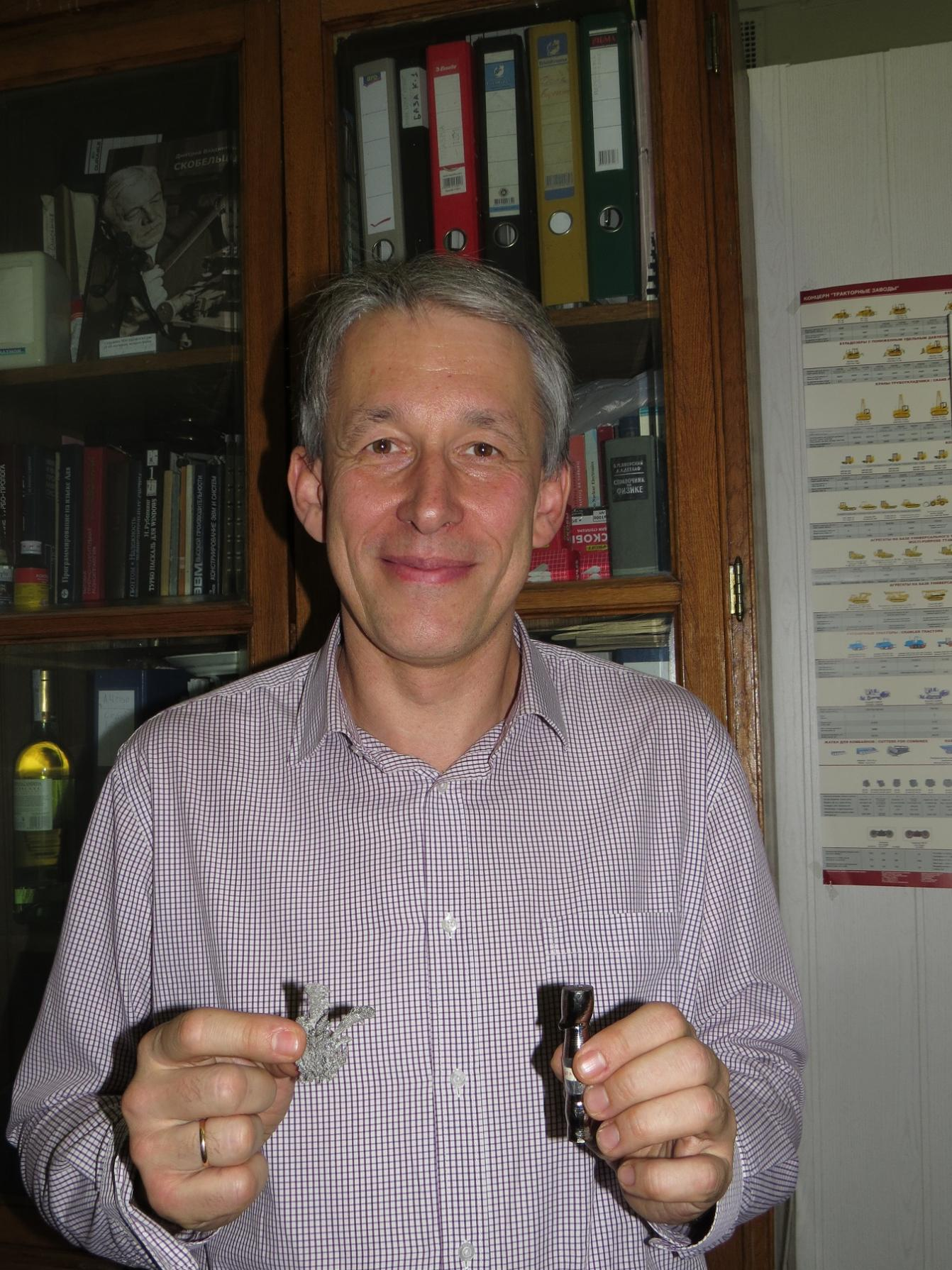 SINP scientist Alexander Chepurnov with the samples of Titanium with l...